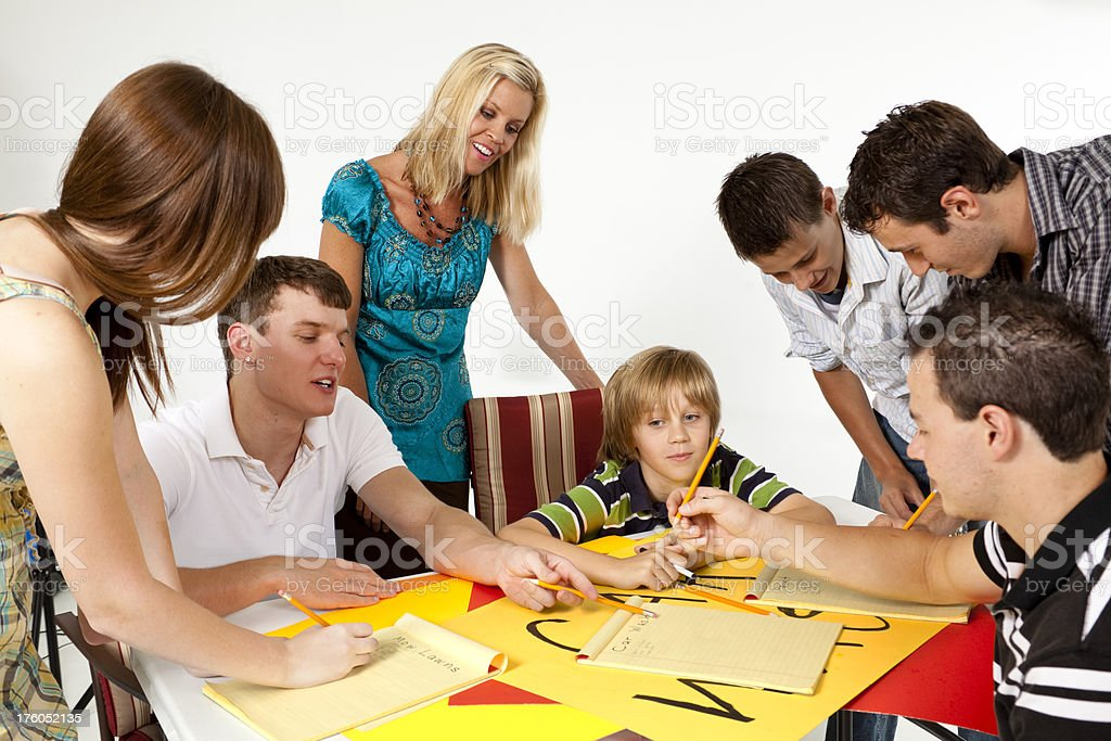 Youth group planning a car wash.  Mixed ages royalty-free stock photo