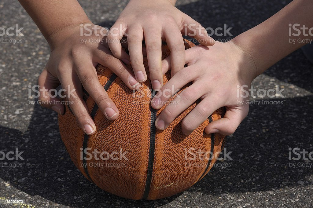 youth hands on basketball stock photo