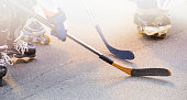 Street hockey with sticks and rollers
