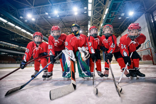Youth hockey team - children play hockey stock photo