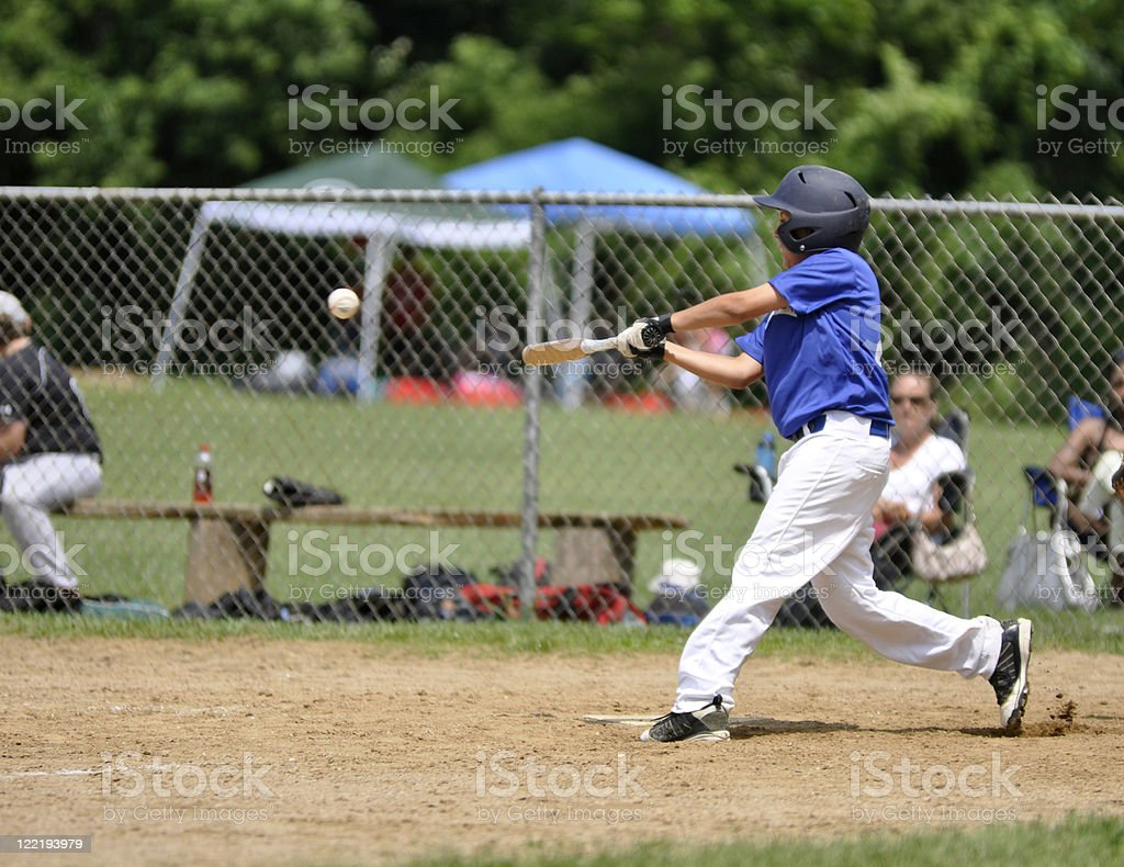 youth league baseball player stock photo
