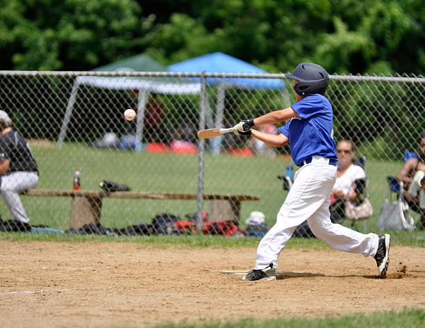youth league baseball player stock photo