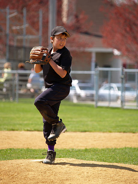 youth league pitcher stock photo