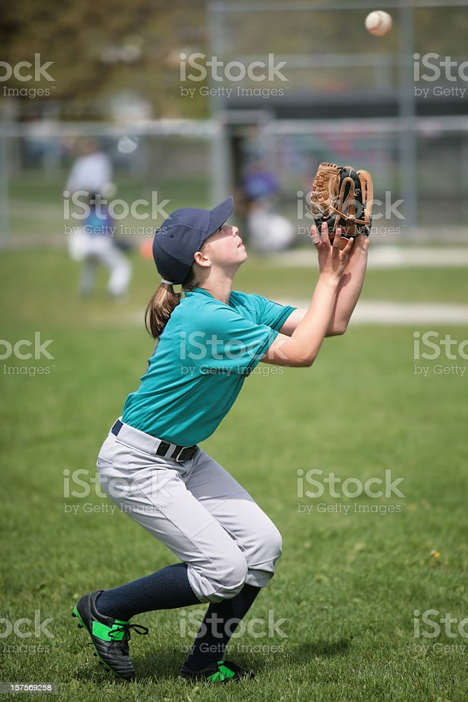 Youth League Player about to catch baseball royalty-free stock photo