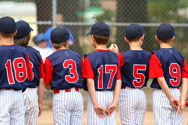 youth league teammates - sports uniform stock photos and pictures