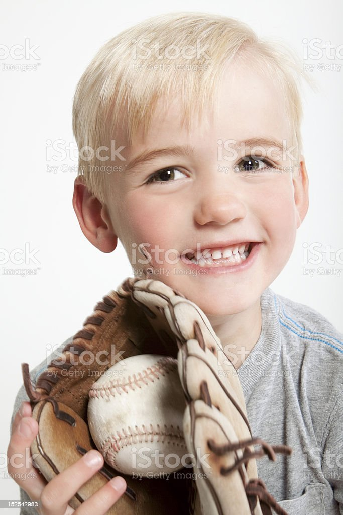 Youth with Baseball in Glove stock photo