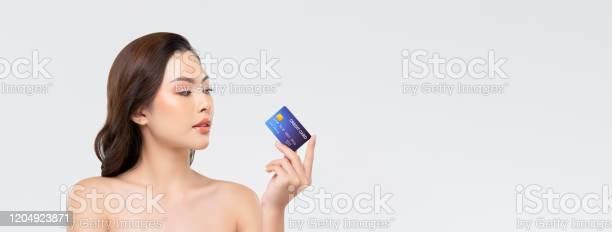 Youthful beautiful asian woman showing credit card on banner picture id1204923871?b=1&k=6&m=1204923871&s=612x612&h=umwawwrrknwea1uwkncymyny2tx372 ygvd6mi5lqtm=