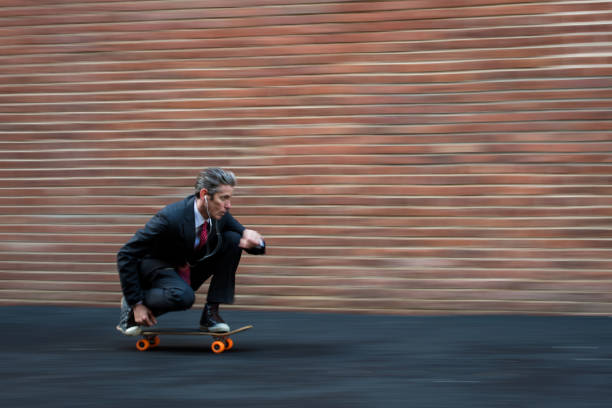 Youthful businessman Motion blurred businessman skateboarding agility stock pictures, royalty-free photos & images