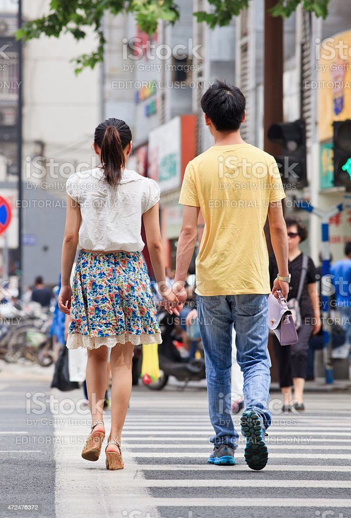 Youthful couple hand in hand on the street, Nanjing, China stock photo