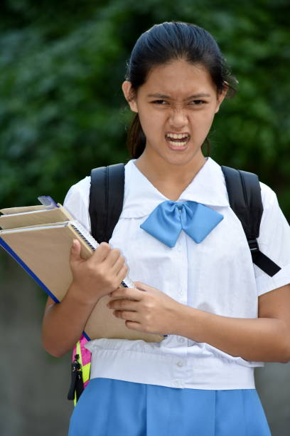 Youthful Diverse School Girl And Anger A person in an outdoor setting antagonize stock pictures, royalty-free photos & images
