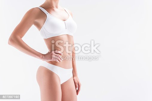istock Youthful fit girl wearing comfortable set of panties and bra 827397192