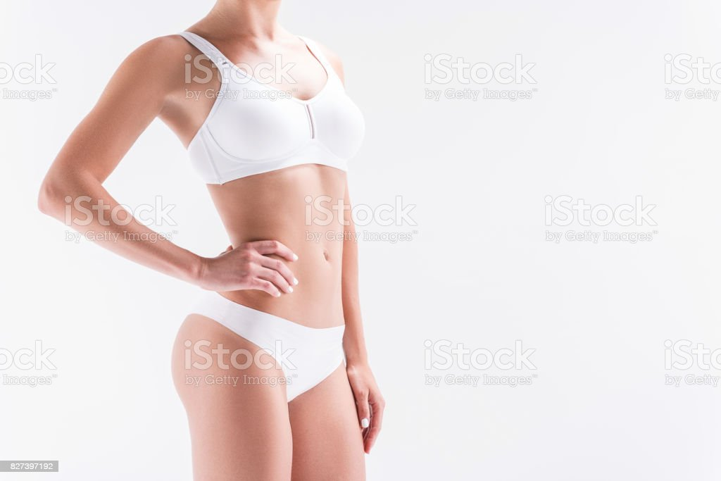 Youthful fit girl wearing comfortable set of panties and bra stock photo