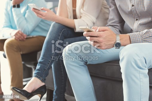 istock Youthful males and lady waiting in queue for job interview 817341766