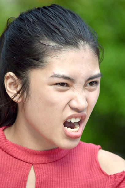 Youthful Minority Female Youngster And Anger A person in an outdoor setting antagonize stock pictures, royalty-free photos & images