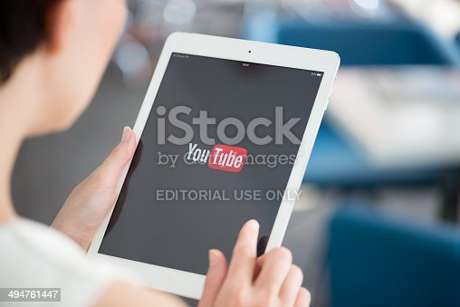 Kiev, Ukraine - May 21, 2014: Woman holding a brand new Apple iPad Air with YouTube logo on a screen. YouTube is the world's most popular online video-sharing website that founded in February 14, 2005