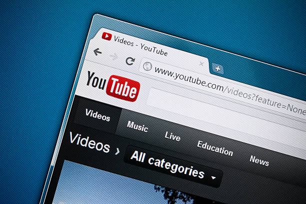 YouTube homepage against a blue background stock photo
