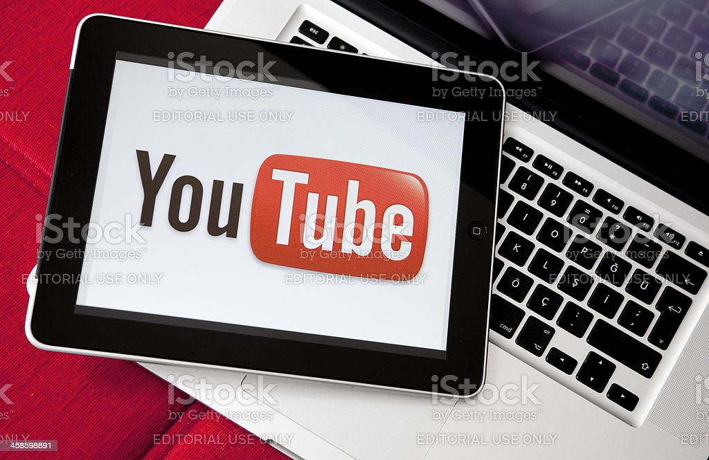 Youtube logo on iPad screen Antalya, Turkey - May 6, 2011: iPad is on the Apple Macbook Pro. Youtube logo on iPad screen.  Youtube is the largest video sharing website in the world. Big Tech Stock Photo