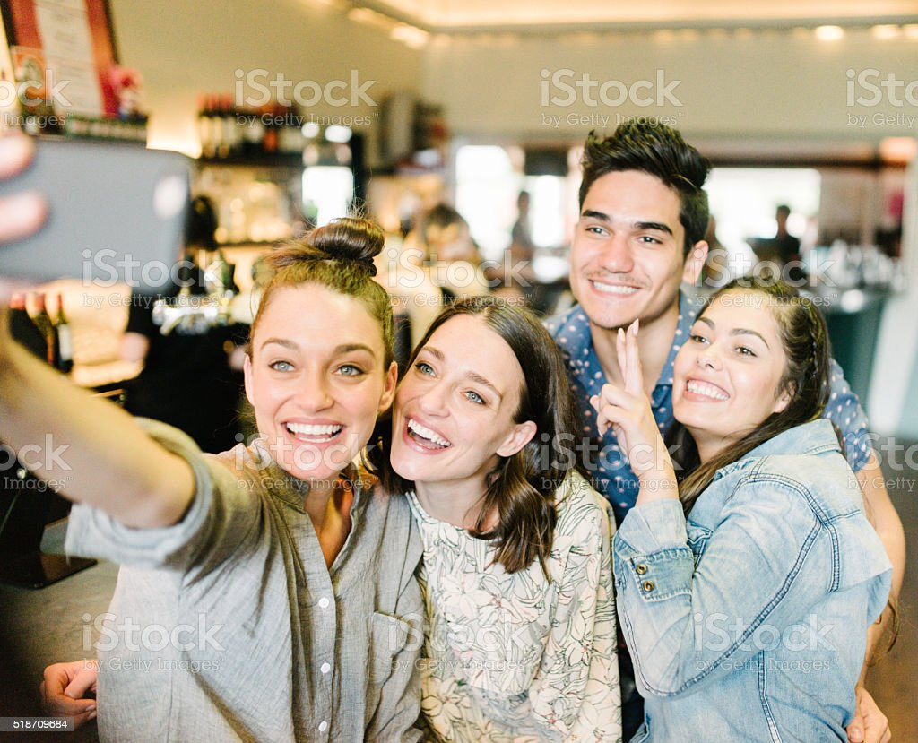Youung Australians taking Selpie in a bar stock photo