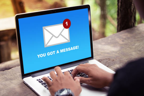 You've got a mail message on laptop screen concept stock photo