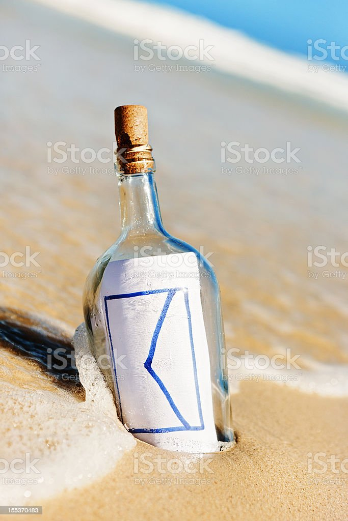 You've got mail! Email icon message in bottle on beach royalty-free stock photo