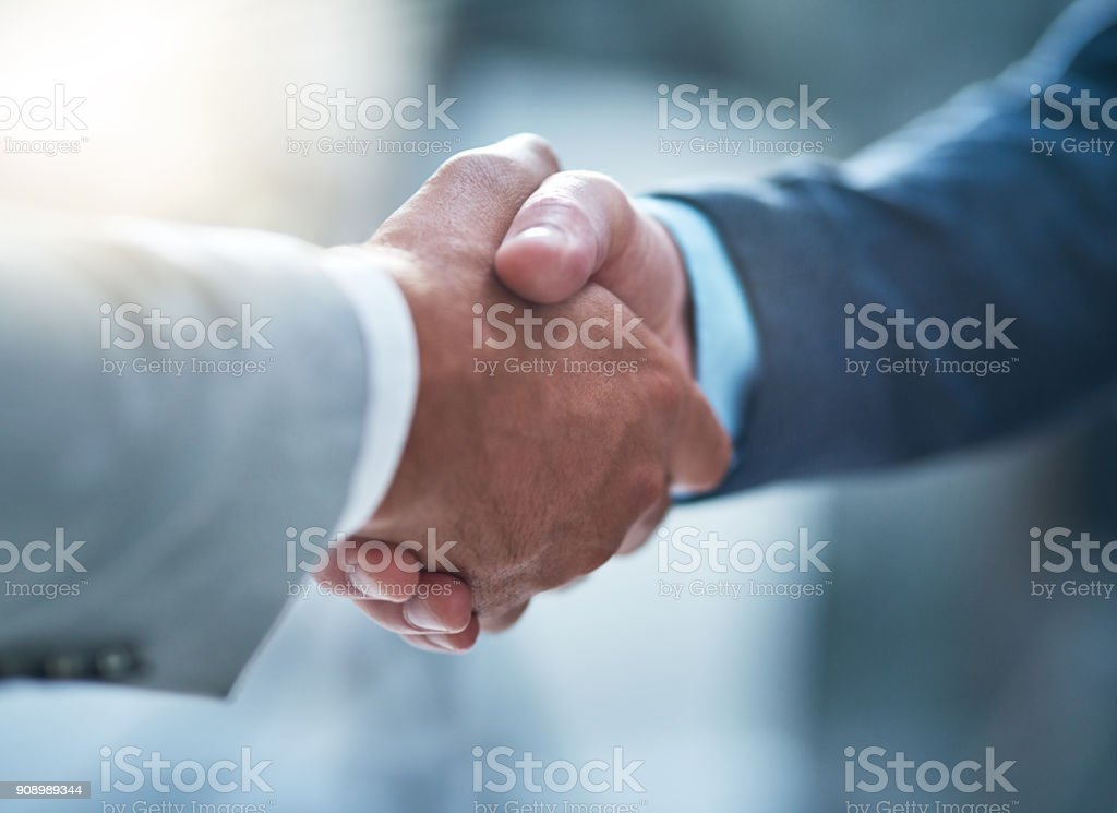 You've got yourself a deal Cropped shot of two unrecognizable businessmen shaking hands after making a deal in the office Adult Stock Photo