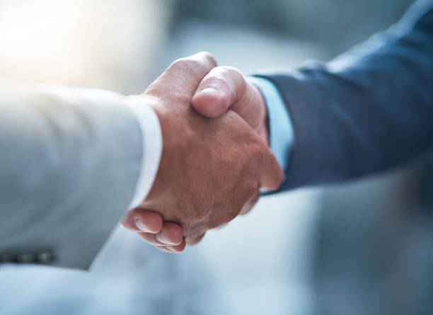 You've got yourself a deal Cropped shot of two unrecognizable businessmen shaking hands after making a deal in the office alliance stock pictures, royalty-free photos & images