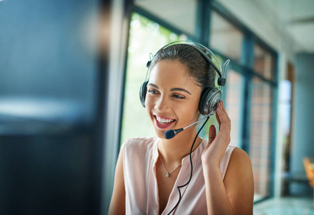 You've reached our support line Shot of a young woman working in a call center call centre photos stock pictures, royalty-free photos & images