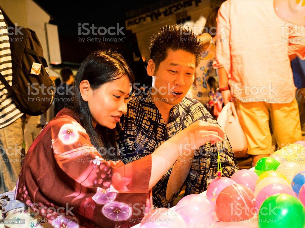Yo-Yo picking at the festval stock photo