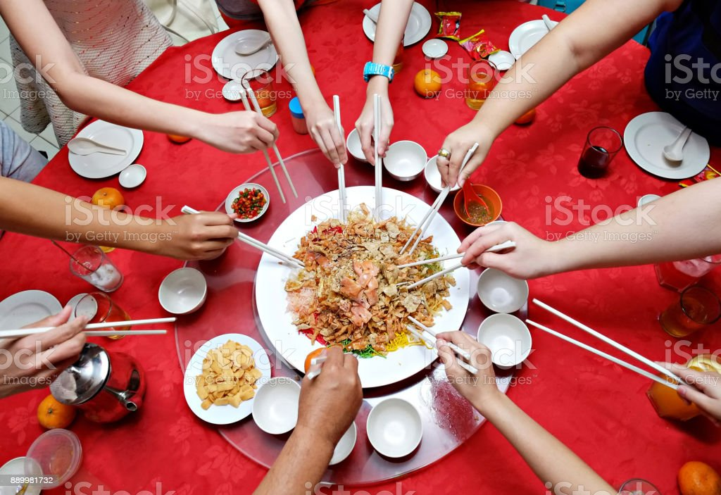 Yu Sheng Spring Toss also known by Yee Sang Chinese New Year Dish for Prosperity Toss Celebration stock photo