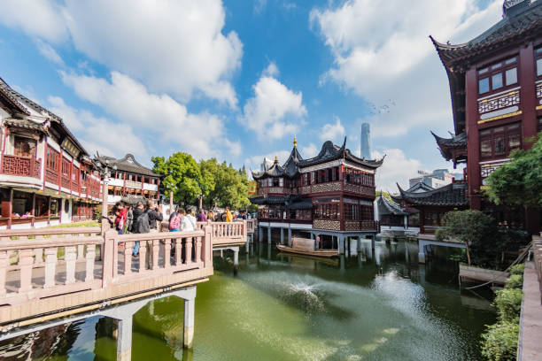 Yu Yuan Gardens area of Shanghai with a lake stock photo