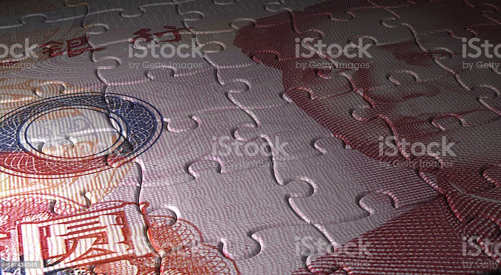 Yuan and Puzzle stock photo