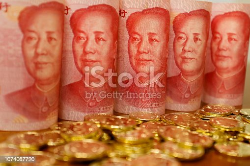 Yuan notes from China's currency. Chinese banknotes. Chinese coins.The concept of wealth fund savings and financing.The head of Chinese leader Mao Zedong.