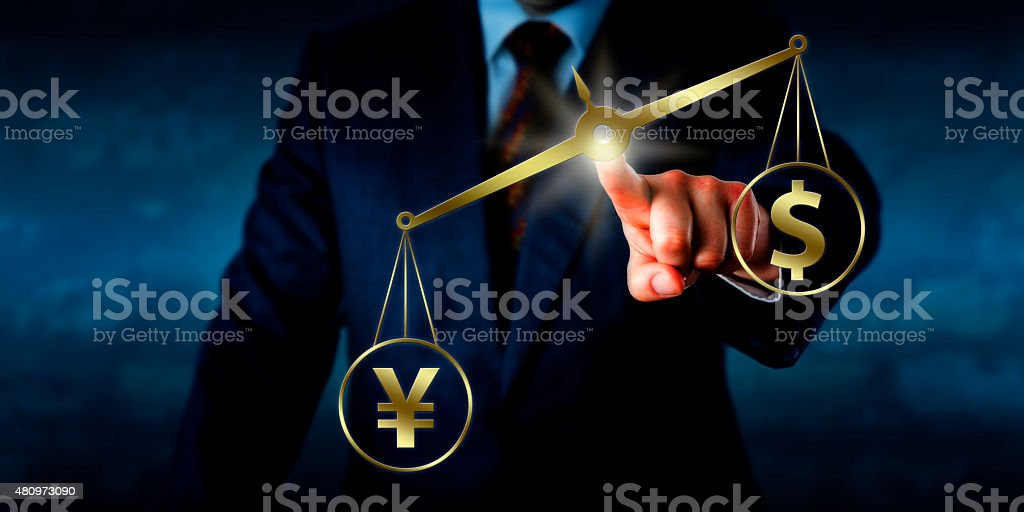 Yuan Outweighing The Dollar On A Golden Balance stock photo