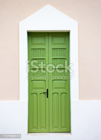 Yucatan, Mexico: Green Wood Door in Pink Wall.