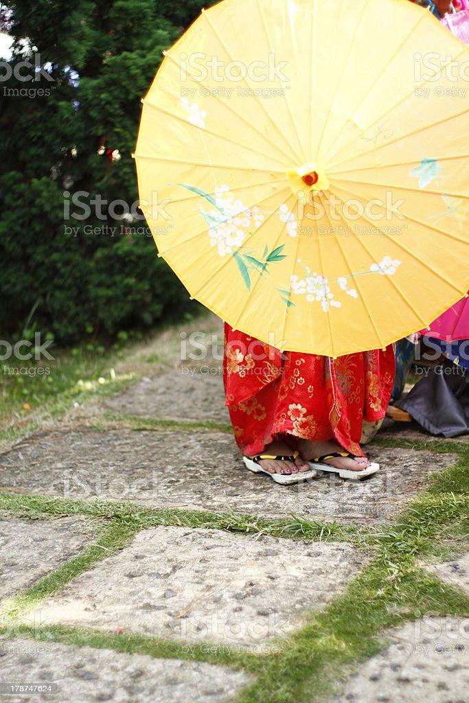 Yukata and yellow umbrella stock photo