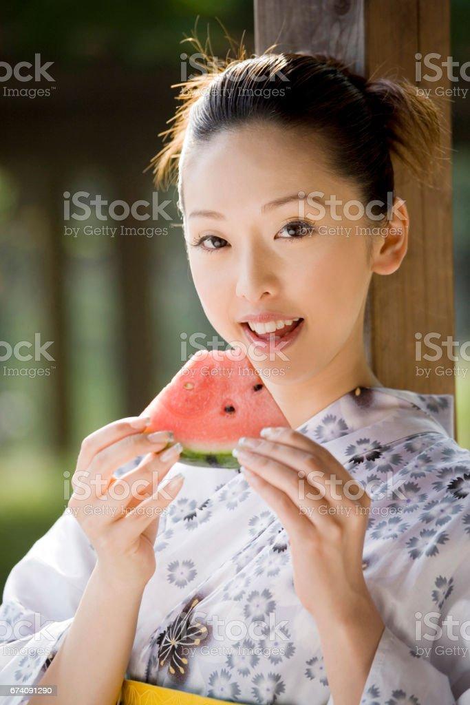 Yukata girls eating watermelon royalty-free stock photo