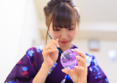 Yukata woman paining colors from indie of Japanese wind bell