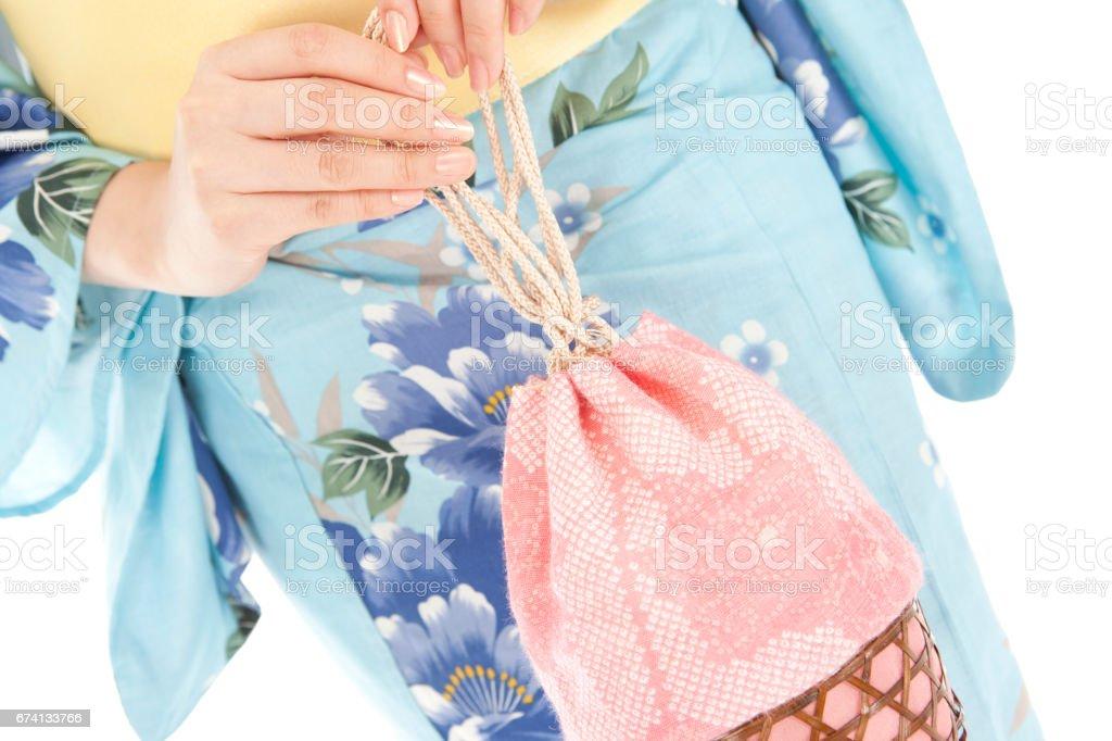 Yukata woman with a bag in hand stock photo