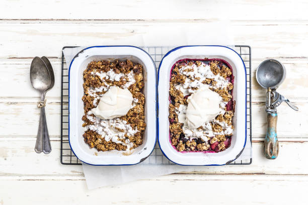 yummy apple crumble & berry crumble dessert - anthony mcgovern stock photos and pictures