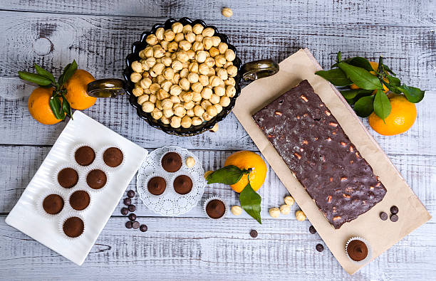 yummy chocolate sweets with hazel nut and tangerines stock photo