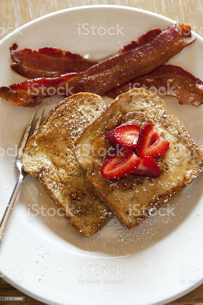 Yummy French toast with berries and bacon slices. royalty-free stock photo