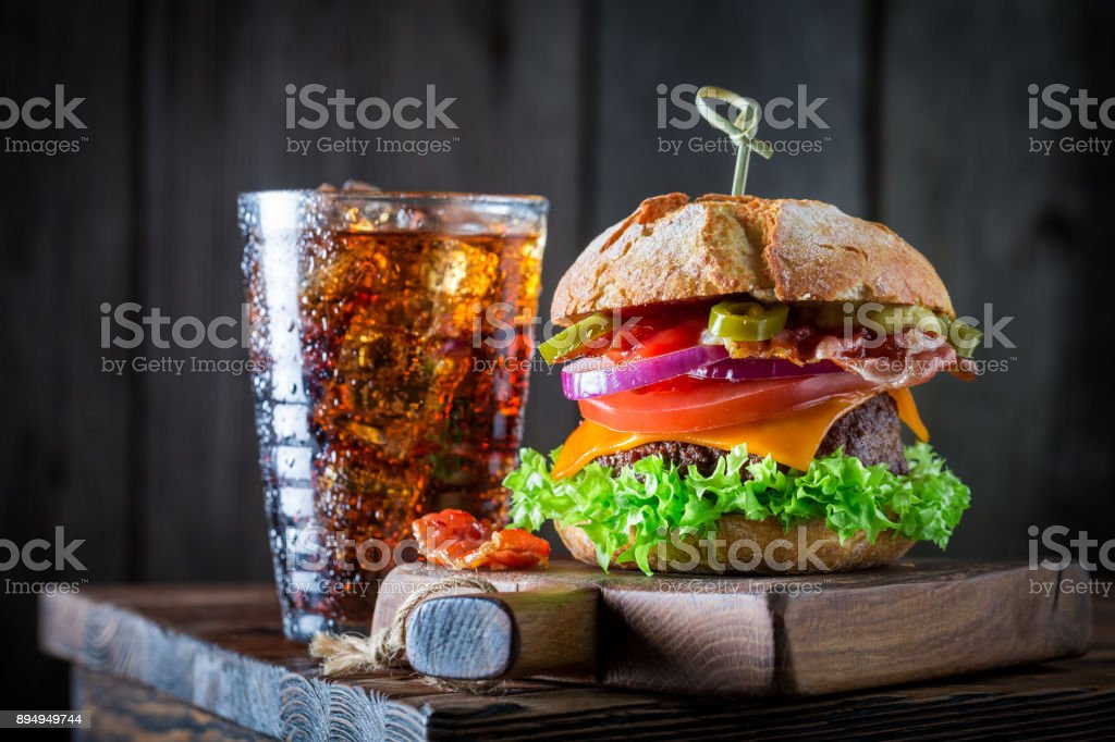 Yummy hamburger with beef, cheese and vegetables stock photo