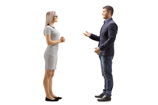 Yung man and woman standing and talking
