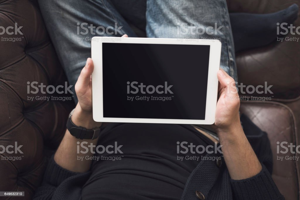 Yung man using tablet pc stock photo