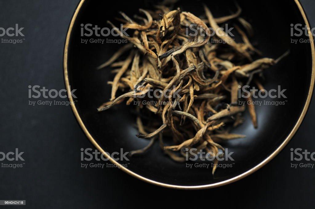 Yunnan Jinhao Hongcha black tea leaves - Royalty-free Black Color Stock Photo