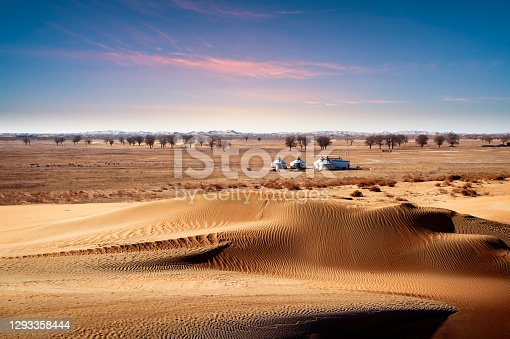 Yurt dwellings on the edge of desert,