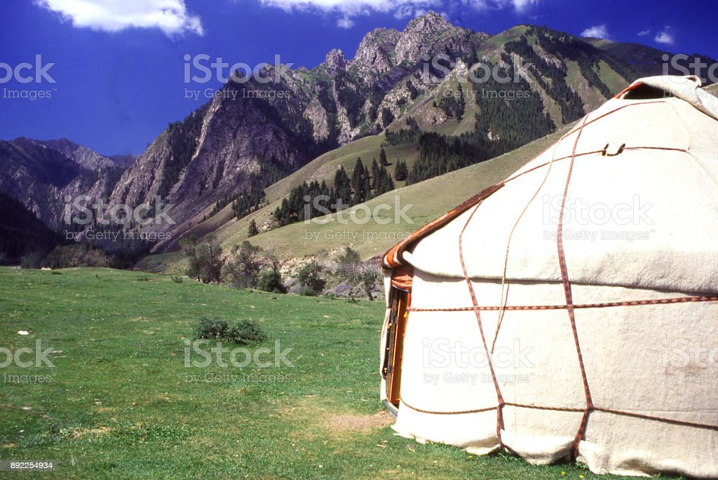 Yurt in alpine meadows below Heavenly Lake in the Tien Shan Mountains near Urumqi Xinjiang China stock photo
