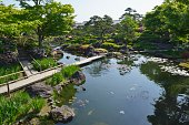 Matsue, Shimane, Japan - May 2, 2014: Yuushien Garden is a beautiful traditional Japanese garden located in centre of Daikonshima Island in Matsue, Shimane. It is famous for peonies and it has seasonal flowers, trees, ponds and waterfalls.