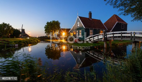 A view to Zaanse Schans, a main touristic attraction in the Netherlands, during twilight.