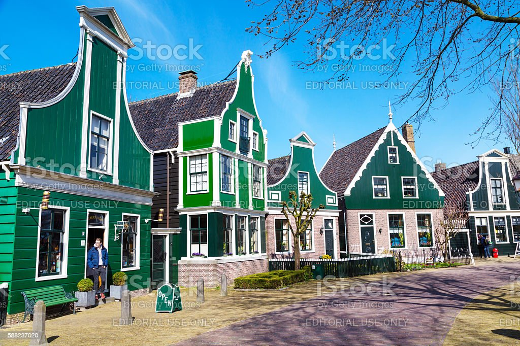 Zaanse Schans village, Holland, green houses against blue cloudy sky stock photo